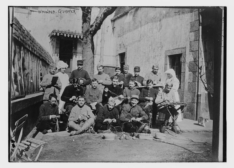soldiers making baskets outside of a hospital in France